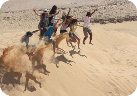 jumping at sand dunes kibbutz lotan