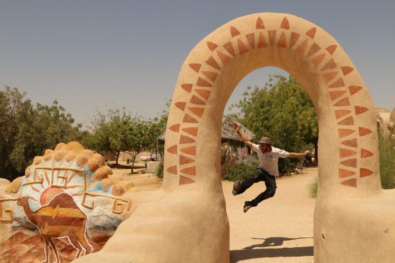 a man jumps at eco campus libbutz lotan gate