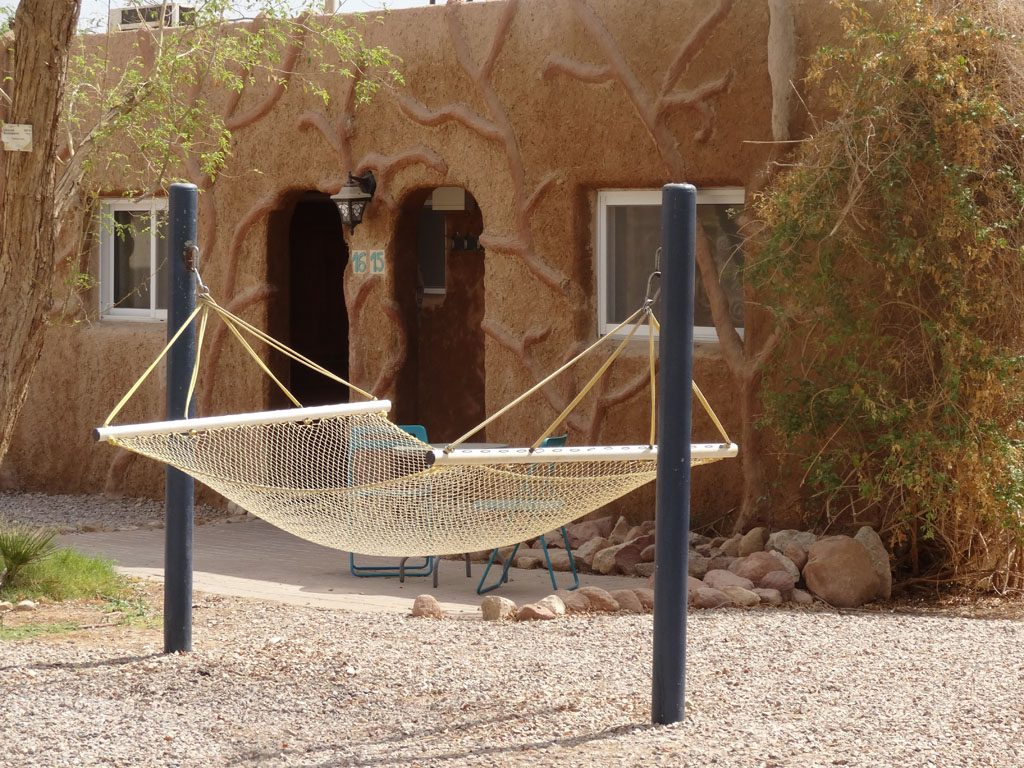 kibbutz lotan guest house. mud covered room with hammock outside