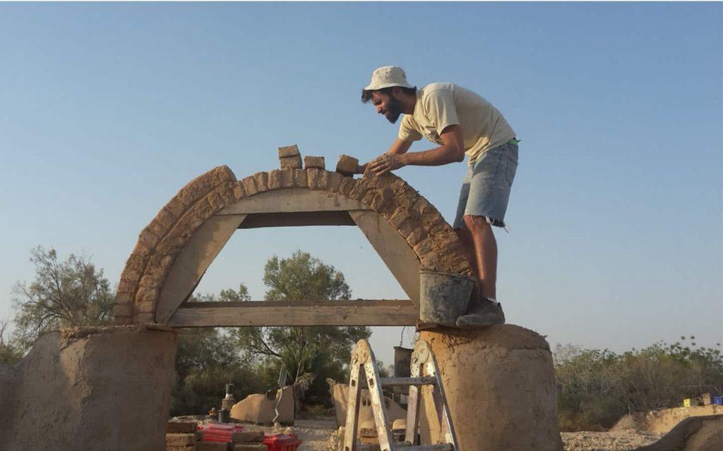 mud building kibbutz lotan