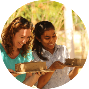 2 women making mud bricks